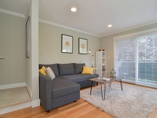 The living room is warm and inviting, with a sleeper sofa and TV