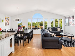 The open concept living area is light-filled and airy