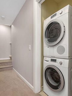 The unit is equipped with a full-size washer/dryer located on the lowest level of the home