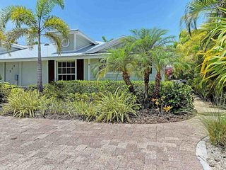Bright, breezy home with private pool only a short walk away from the beach!