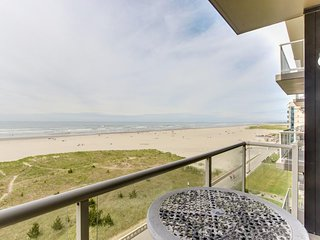 Homey oceanfront Sand & Sea condo ! Balcony w/views, shared pool & sauna access!