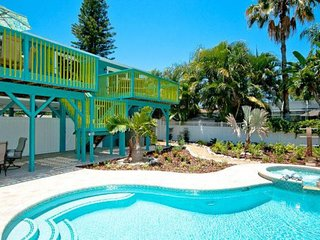 Colorful home w/ pool, hot tub, decks & terrace/bar - walk to beach, dogs OK!