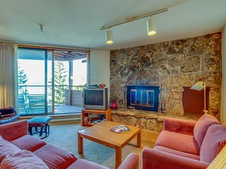 Lakefront condo w/ mountain views, shared hot tub - walk to town & ski access
