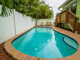 Two family-friendly cottages with two private lagoon pools, dogs okay!