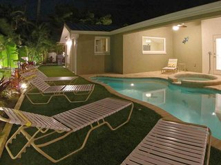 Ground floor family home with a private heated pool and spacious backyard