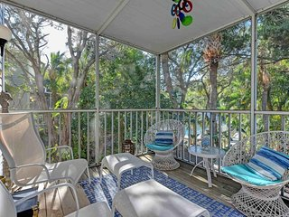Dog-friendly condo w/ shared pool & island views - walk to the beach!