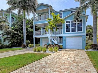 Spacious and bright home w/ heated private pool, one block to white sand beach!