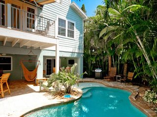 Dog-friendly house with private lagoon-style pool, waterfall, & Tiki bar