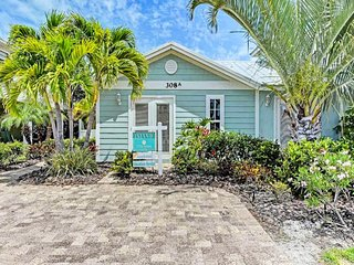 Tropical and dog-friendly retreat with a private pool - walk to beach!