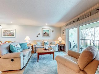Waterfront home with sweeping views and shared pool - walk to the beach!