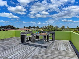 Colorful dog-friendly beach home with private pool, hot tub, and rooftop deck!