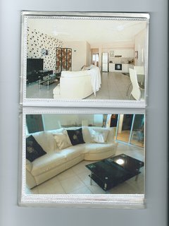 lounge with uk tv and fitted fan and aircon