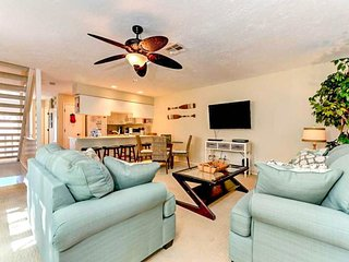 Dog-friendly beach condo with a screened lanai and community pool