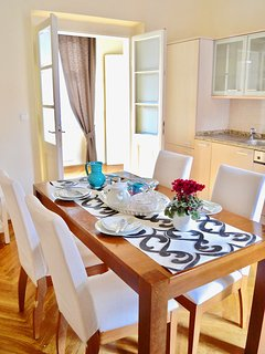 Separate kitchen with dining table.