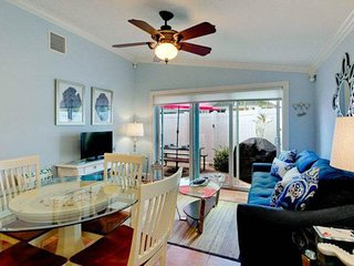 Family condo with a private patio, grill, and shared pool - dogs welcome!