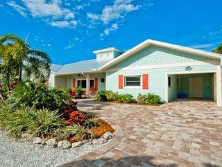Bright and beachy with a private pool and hot tub - beach across the street!