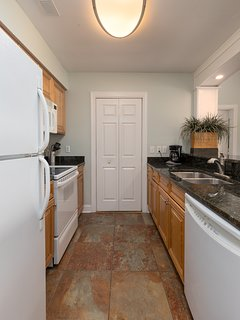 Fully appointed kitchen with washer/dryer in closet