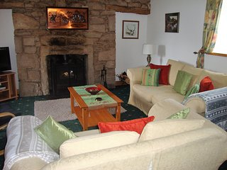 Spacious cosy lounge with log burning fire for those cosy nights.  Lovely views of the countryside.