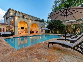 Luxury canal-front home with dock, pool & elevated deck - blocks to beach!