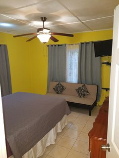 Master bedroom with Queen size bed, futon bed, A/C and Ceiling Fan