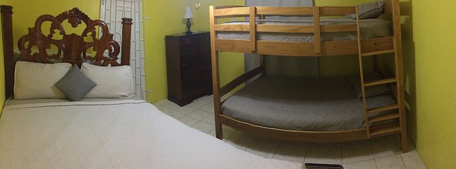 Second bedroom with Queen size bed and double size bunk bed, A/C and Ceiling Fan.