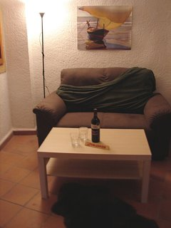 The living room, with a welcoming bottle of fine Valencian wine and bar of Toblerone on the table