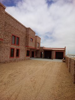 Flat 3 at the back with single garage (right) and open car port (center)