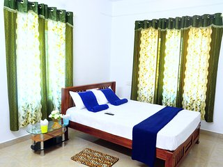 Home stay 100% homely feel with pleasant ,neat,calm and a mint climate Bedroom 8