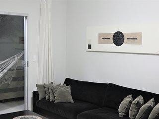 Varanda, com rede, vista a partir da sala