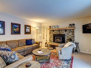 Main floor living room with wood-burning fireplace