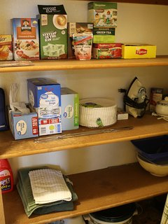 Pantry with coffee, tea, cook books, and more to enjoy your stay!