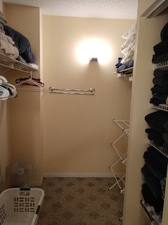 master walk-in closet with plenty of extra pillows, towels and blankets