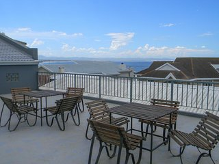 Lovely condo w/ upstairs oceanview patio, & shared pool - steps from the beach!