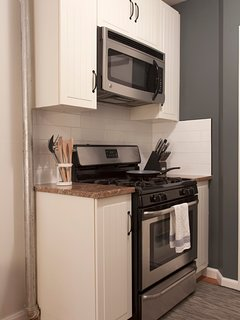 Small galley kitchen with oven and microwave/ convection oven.