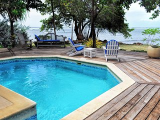 2BR Ocean Front Bungalow with pool, deck and wifi