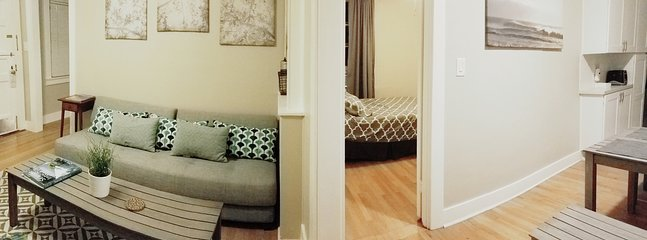 panoramic shot showing doorways to both bedrooms