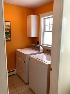 Downstairs half bath with washer and dryer.