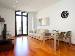 Living Room with Sofa bed and balcony with Tibidabo mountain views.