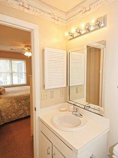 The en suite bath has a walk-in shower.