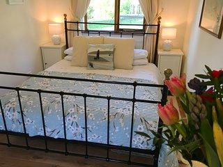 Lovely super king size bed with en suite shower room. TV in bedroom.