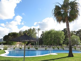 Close to beach lovely self-catering, 2 bed, 2 bath apt, view over gardens & pool
