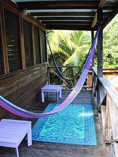 Second floor deck with hammocks overlooking the pool.