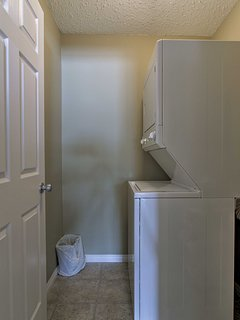 The in-unit laundry machines come with soap detergent provided.