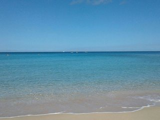 Enjoy a swim at Queen's Bay beach. Just a 4 minute stroll from your Island GetAway Vacation Rental