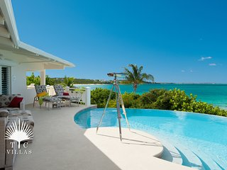 Turtle Beach Villa 5BR on Grace Bay Beach with beach hammocks and pool