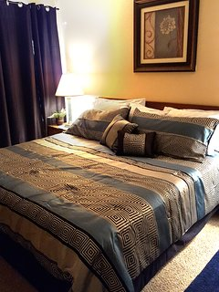 King size bed, black out curtains, flat screen tv, cable and free WI-fi in our master bedroom.