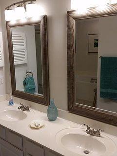 2 separate double sink, full designer & vanity makeup mirrors.