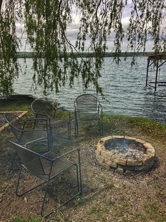 Enjoy a bonfire in the bonfire pit right by the lake. ©2017