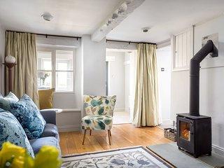 Living room with beams, wood burner, window seat, freeview TV