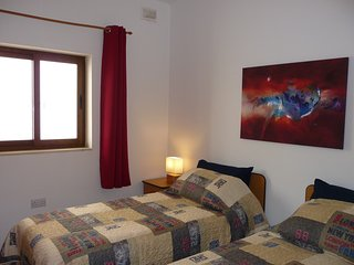 Bedroom + bathroom in Marsaxlokk; 15 minutes from airport; 300 meters from beach